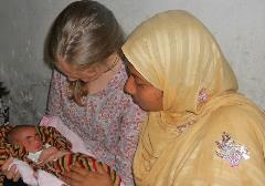 VTC researcher with mother and baby in Dhaka