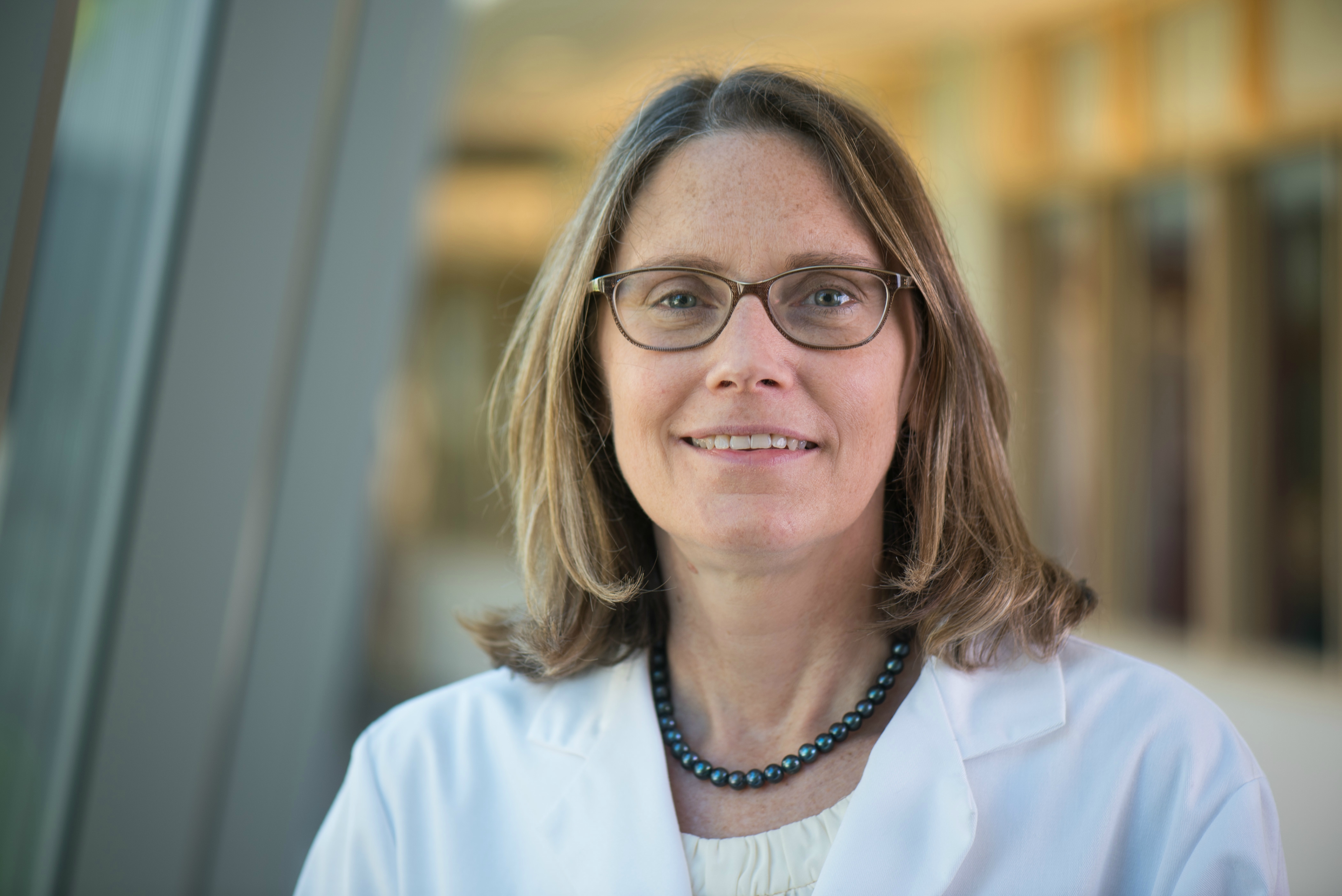 Beth Kirkpatrick, MD, head shot in white coat
