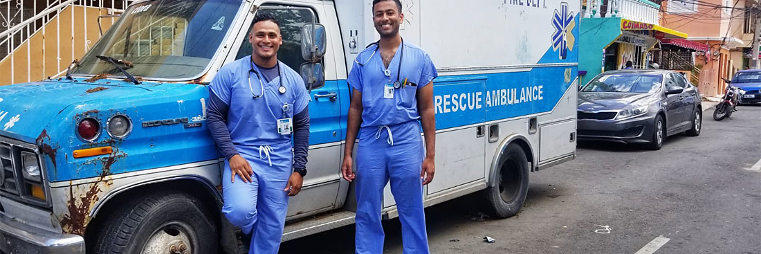 Students standing next to an Ambulance in the Dominican Republic