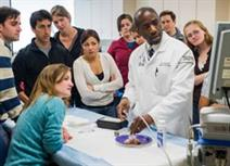 Dr. Ted James demonstrates with a group of students