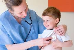 Physician listening to a small child's heart