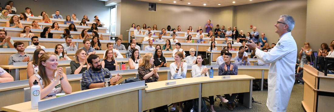Dean Richard L. Page speaks to first year medical students in sullivan classroom