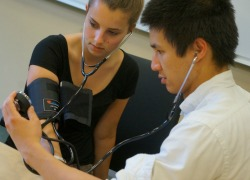 Students using a blood pressure cuff