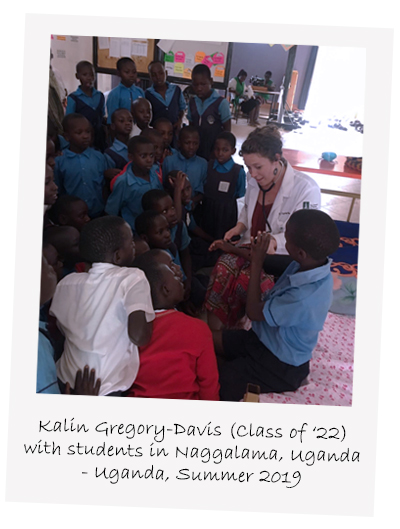 Kalin Gregory-Davis with students in kampala uganda