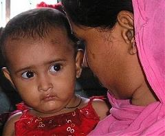 Mother holding her child in Dhaka, Bangladesh
