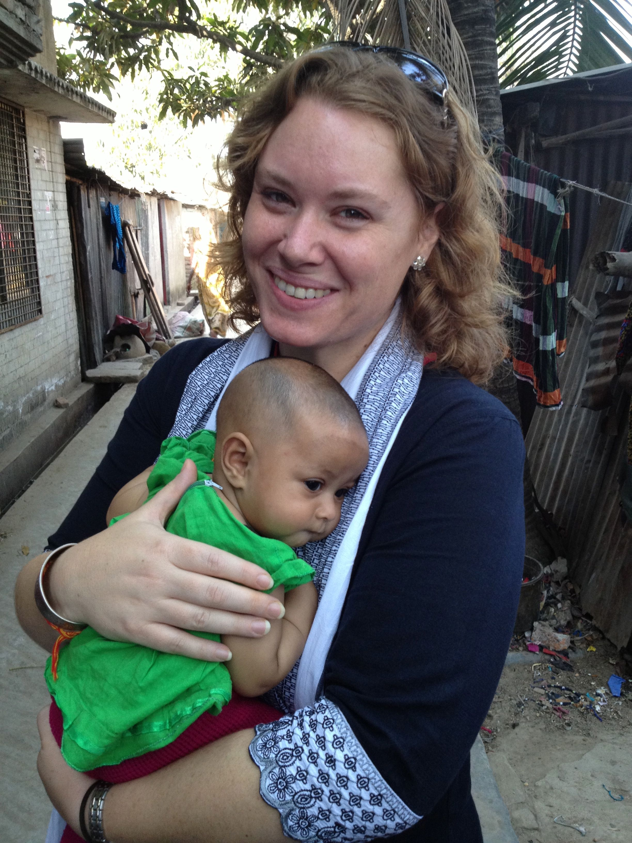 Ross Colgate, PhD holding baby in Dhaka