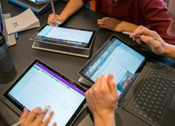 Students using Surface computers