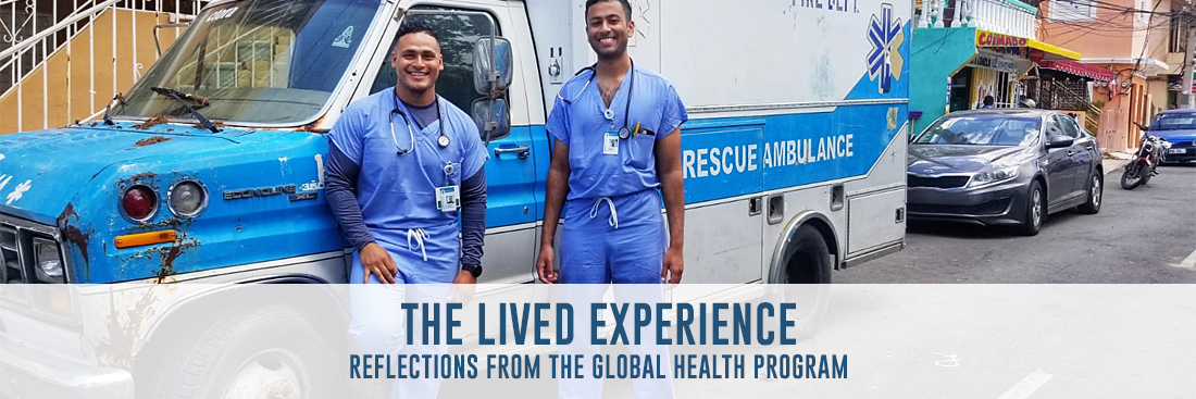 medical students jose calderon and prasanna kumar pose in front of an ambulance in the dominican republic while on their global health elective during summer 2019