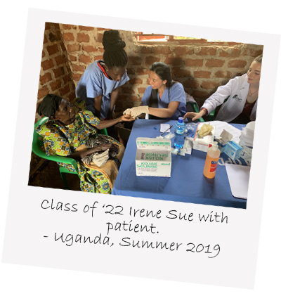 UVM Larner College of Medicine Class of 2022 medical student Irene Sue with patient during summer 2019 global health elective trip to uganda