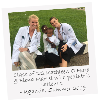 UVM Larner College of Medicine Class of 2022s Kathleen OHara and Elena Martel sit with two pediatric patients Uganda summer 2019