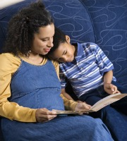 Mom reading to male child