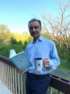 Dr. Khan reading the first year book