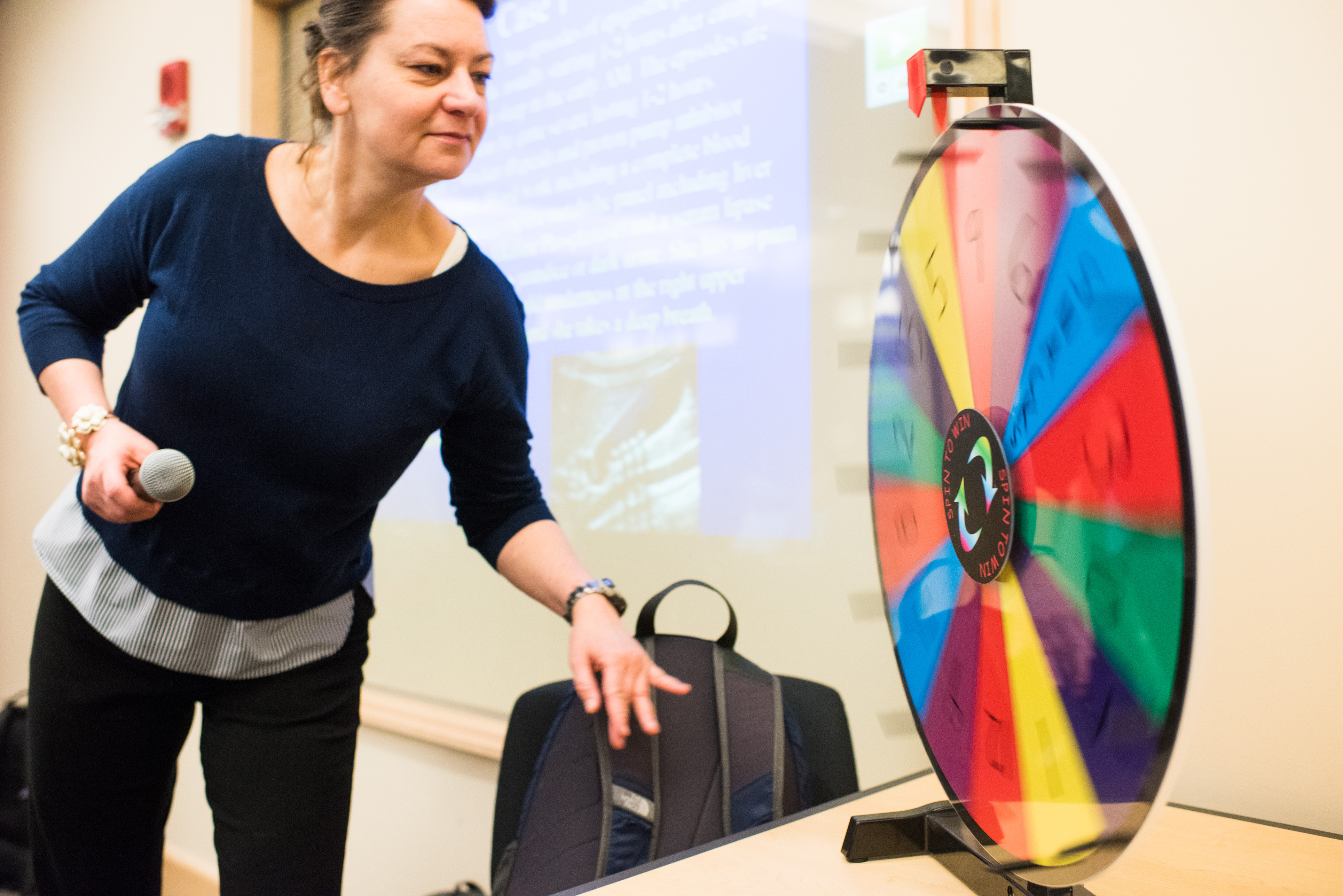 Student spinning wheel in active learning classroom